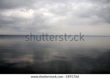 Cloudy Lake Reflection - stock photo