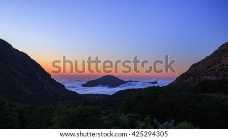 Cloudy Landscape covering the hills of Sicily. Lovely evening Sunset in the Madonie Mountains of Italy, Europe. Tranquil Serene Atmosphere