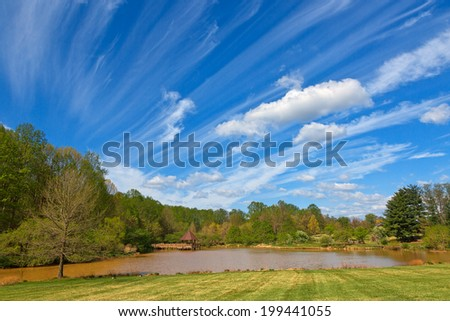 Cloudy landscape & pond scenery from Meadowlark Gardens in Vienna, Virginia (USA). HDR composite from multiple exposures. - stock photo