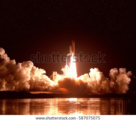 "Cloudy launch of rocket into  outer space. ""The elements of this image furnished by NASA"""