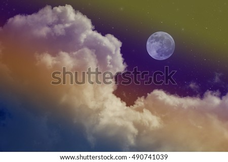 cloudy night sky with moon and star