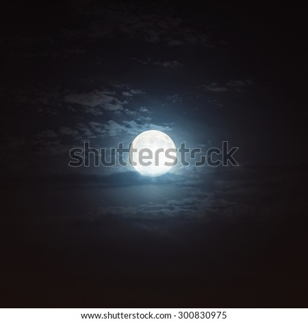 Cloudy night sky with moon.  Elements of this image furnished by NASA.