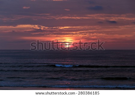 Cloudy orange sea sunset, north of Portugal. - stock photo