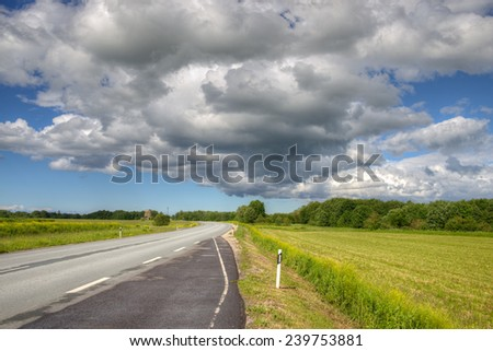 Cloudy path in summer afternoon. Western Estonia, highway Tallinn - Narva