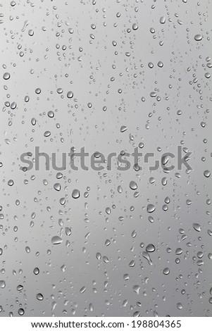 Cloudy, rain drops on window glass, background - stock photo