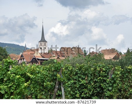 cloudy scenery showing Mittelbergheim, a village of a region in France named Alsace - stock photo