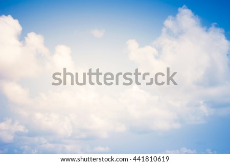 Cloudy skies in the summer heaven. Natural background abstract style vintage tone. - stock photo
