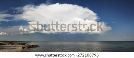 Cloudy sky above a sea, panorama - stock photo