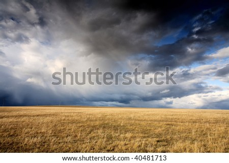 cloudy sky and meadow in Autumn