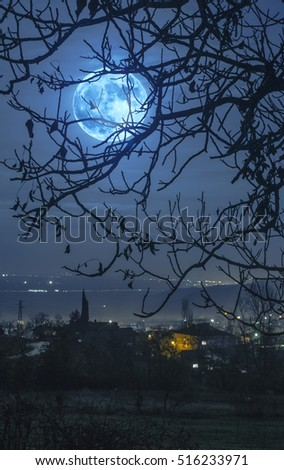 Cloudy sky and moon in the night. Moonlight over city