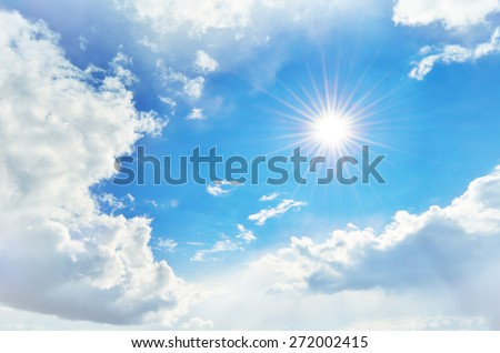 cloudy sky and the sun with rays - stock photo