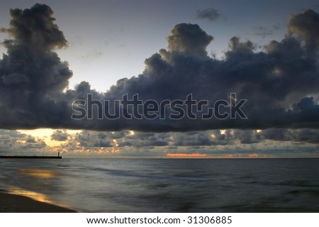 Cloudy sky at the Baltic sea. Just after sunset. Poland.