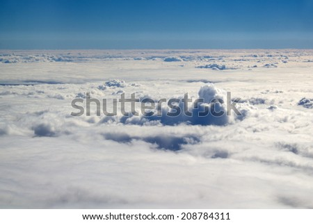 Cloudy Sky background, view from airplane window.