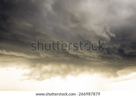 Cloudy sky full of deep grey clouds. Storm cloud - stock photo