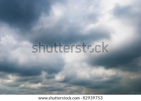 Cloudy sky full of deep grey clouds. Storm is coming. - stock photo