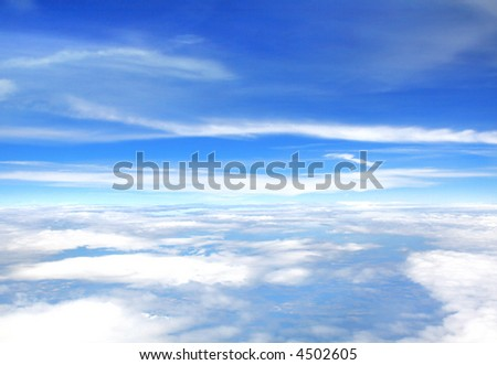 cloudy sky high above the earth, view from an aeroplane - stock photo