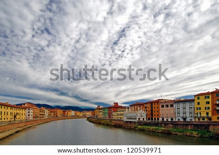 Cloudy Sky Over A Large River in Italy