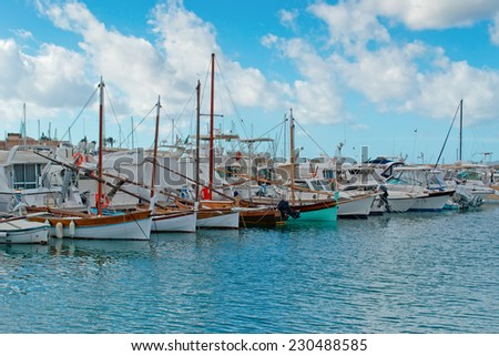 cloudy sky over boats in Alghero port - stock photo