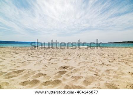 cloudy sky over Le Bombarde beach in Alghero - stock photo