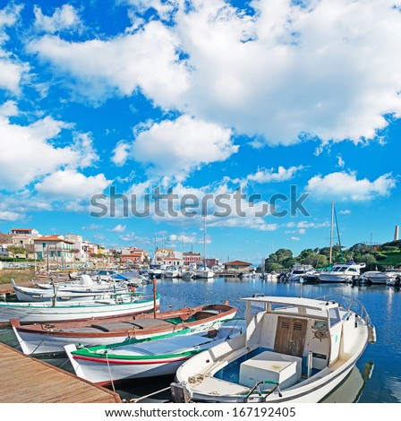 cloudy sky over Stintino small port - stock photo