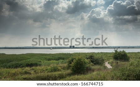 Cloudy sky over the river Thames in Purfleet, Grays, Essex - stock photo