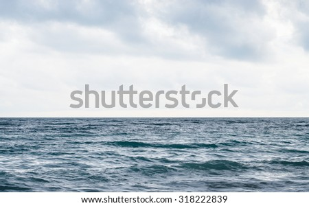 Cloudy sky over the sea - stock photo