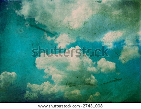 cloudy sky over vintage background paper - stock photo