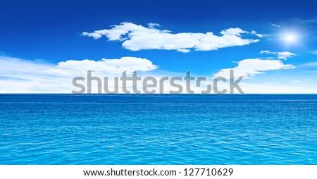 Cloudy sky, sea and sun. Tropical horizontal composition - stock photo