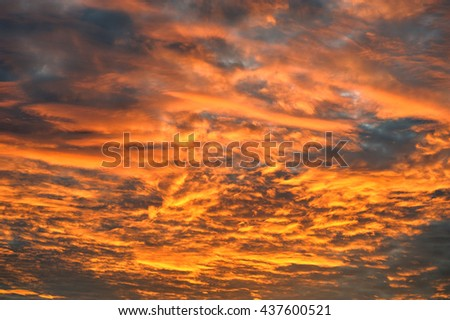 Cloudy stormy dramatic sky background, Dark ominous grey and red storm clouds, Abstract dark background ,Dark clouds, Sky like scattered bombs, Beautiful Red Sunrise Dawn - stock photo