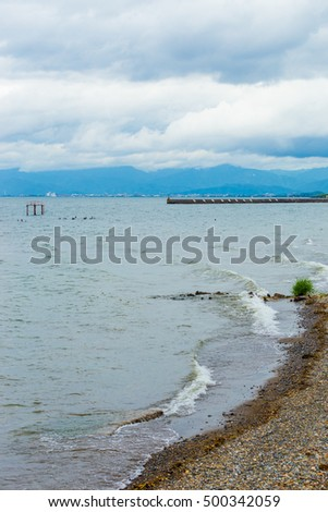 Cloudy, stormy weather above Lake Biwa along the shores of Hikone, Japan. Vertical