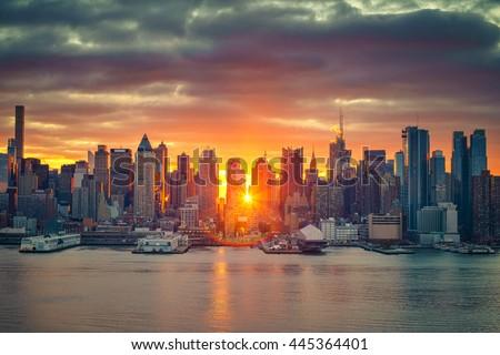 Cloudy sunrise over Manhattan, New York - stock photo