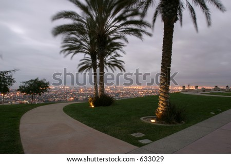 Cloudy sunrise over the city - stock photo