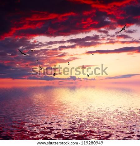 Cloudy sunrise seascape - stock photo