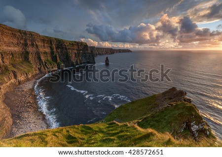 Cloudy sunset at Cliffs of Moher, Ireland - stock photo