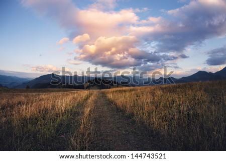 Cloudy sunset in Carpathian mountains, Ukraine - stock photo