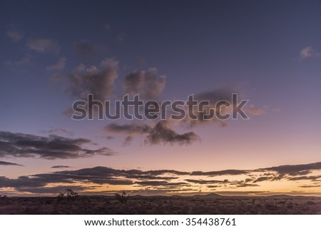 Cloudy Sunset in the Australian Outback  - stock photo