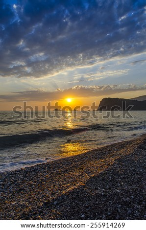 Cloudy Sunset over the sea - stock photo