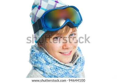 Clouse up portrait of a caucasian cute teenager in ski goggles and a scarf, isolated on white - stock photo