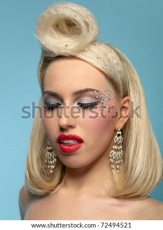 Clouse-up portrait of beautiful blond woman with fashion make up and hairstyle, eyes closed - stock photo