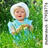 Clouse-up portrait pretty little girl sitting in the grass in the park - stock photo