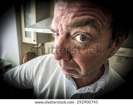 clouse-up with fish eye funny face of mature unshaving man - stock photo