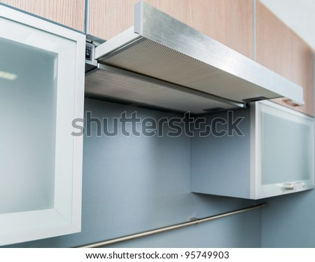 Clouseup range hood - detail of a modern kitchen - stock photo