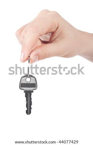 clouseup shot of a female hand holding keys - stock photo