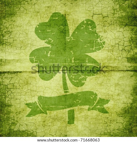 Clover with four leaves in grunge style in the paper - stock photo