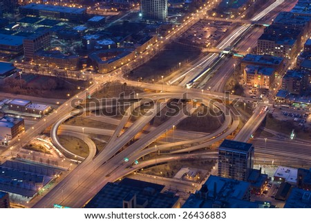 Cloverleaf expressway ramps and city streets at night