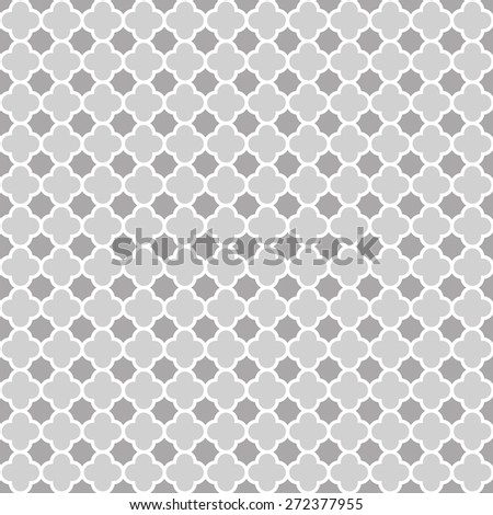 Cloverleaf quatrefoil lattice pattern with white lattice on a grey / gray background. This is a seamlessly repeating pattern background.