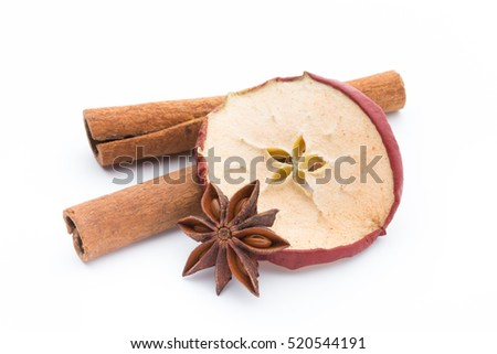 Cloves, anise and cinnamon isolated on white background. Shallow dof.