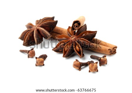 Cloves, anise and cinnamon isolated on white background. Shallow dof - stock photo