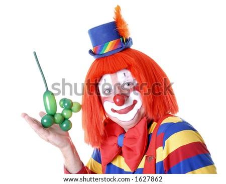 Clown Displaying his Balloon Animal Poodle Dog - stock photo
