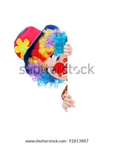 Clown hiding behind the blank board - stock photo